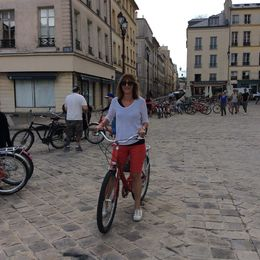 This is me in the town of Versailles about to ride to the market to get our food for picnic. , Tiziana R - August 2015