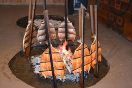 The traditional smoking of the salmon for the Tillicum Village Cultural Experience dinner. It tastes absolutely fabulous! , Patricia G - August 2014