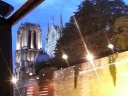 Photo of Paris Dinner Cruise on the Seine River with Hotel Pickup Notre dame as seen from the cruise.