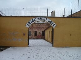 Not the main entrance to the museum, but this used to be the main entrance to the Concentration Camp with the usual wording of 'Arbeit macht frei', Karl G - February 2009