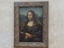 The photo is of the Da Vinci's Mona Lisa at the Louvre Museum , OLGA J - August 2013