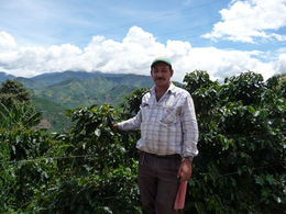 The coffee grower, Alonso explaining coffee production with the magnificent view in the background. , William M - September 2013