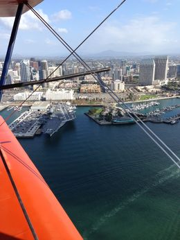 Photo of San Diego Open Cockpit Biplane Sightseeing Ride High above the USS Midway