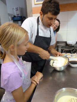My 12 year old daughter learning from the chef how to fold all the ingredients together. , Jennifer S - August 2011