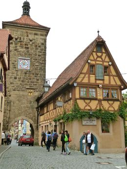 Picturesque houses at the entrance to Rothenburg town , Galen S - June 2016