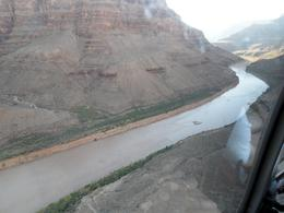 Photo of Las Vegas Ultimate Grand Canyon 4-in-1 Helicopter Tour About to land next to the Colorado River