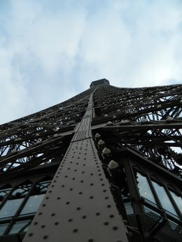 Photo of Paris Skip the Line: Eiffel Tower Tickets and Small-Group Tour Looking up the side of the Eiffel Tower