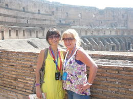Our guide Emanuella (in yellow) and Trish my beautiful wife! Colosseum in the background. , pooley - June 2012