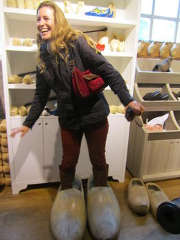 Photo of Amsterdam Zaanse Schans Windmills, Marken and Volendam Half-Day Trip from Amsterdam Trying on clogs at Marken