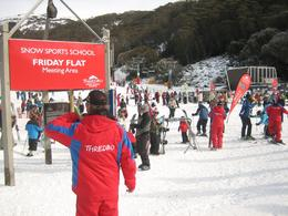 Trainer in red waiting for new skiers, Jason Wuen Jin D - August 2009