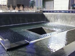 Photo of New York City Walking Tour of Ground Zero with Optional 9/11 Memorial Admission North tower falls