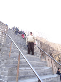 This is Gordon B taking a break climbing the hundreds of steps on the Great Wall of China. A great experience!!! , Gordon B - March 2012