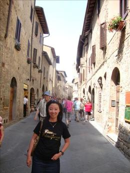 Me inside the old city of San Gimignano. In this town, you can find the best gelato in Italy. Try champagne flavour, that's their best-seller!, Maria natalina S - August 2009