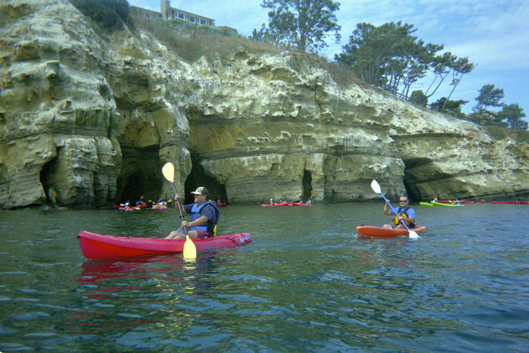 Kayaking past the sea caves - San Diego