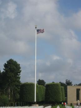 The American Flag waving above the American cemetery in Normandy. - September 2009