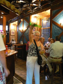 Photo of Madrid Madrid Tapas Night Walking Tour Pouring Cider de Asturias