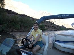 Photo of Las Vegas Ultimate Grand Canyon 4-in-1 Helicopter Tour The Admiral at the wheel of the Colorado river boat (party barge)