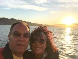 Joe and I watching the sunset from the cruise , Karla H - July 2015