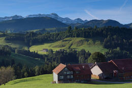 Morning view over an Appenzell farm toward the Alpstein mountain range and the Santis peak in eastern Switzerland - December 2011