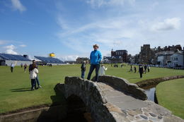 My wife Heather standing on the Swilcan Bridge a week after the Open Championship was hosted there. an awesome day! , Richard W - August 2015