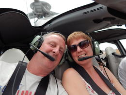 Steve Dockerill and Dawn Dockerill waiting for take off, sitting up front with the pilot , Dawn D - May 2014