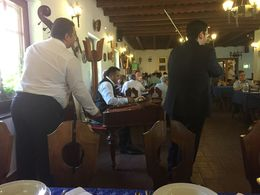 Traditional musicians play during lunch at the farm. , ERIKA L - September 2015