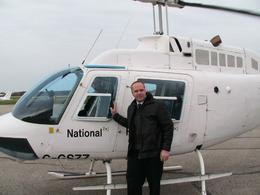 Joe Morello is stepping out the jet Ranger Helicopter at Niagara District Airport after sightseeing Niagara Falls and Niagara's Vineyards from the air. Joe : ), Joe M - October 2009