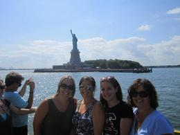 What a thrill to see the Statue of Liberty up close--our tour guide was nice enough to take a picture of me and my daughters! , Sue G - July 2012
