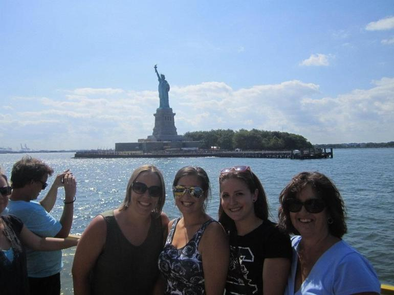 What a thrill to see the Statue of Liberty up close--our tour guide was nice enough to take a picture of me and my daughters!