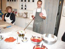 Chef is showing us how to scoop our pizza on the paddle , Ed & Barb - February 2013