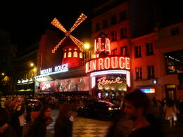 Photo of Paris Viator VIP: Moulin Rouge Show with Exclusive VIP Seating and 3-Course Dinner Moulin Rouge at night