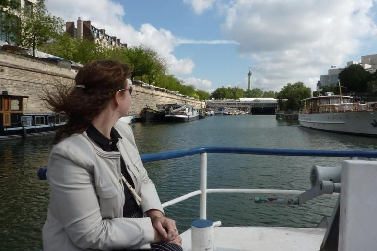 Admiring the Bastille from the Paris Canal as part of the Viator Seine River and Canal Tour