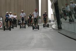 Just cruising down the street on our Segways- what a fun way to view the city! - June 2010