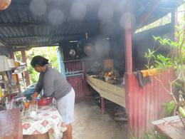 Watching a local woman cook dinner in her home in the outdoor kitchen. , John K - June 2014