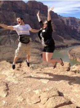 Photo of Las Vegas Grand Canyon All American Helicopter Tour Son  and  Daughter jumping for joy in the Grand Canyon