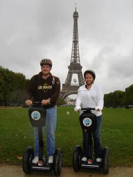 At the Eiffel Tower on our Segway tour, soaked but having fun., Pamela K - October 2007
