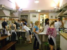 Great shot of everyone working so hard on their fine Italian dinner, Christopher S - August 2010