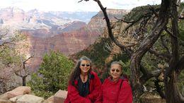 Debbie Herscek and LaVerne Cutrone posing at Grand Canyon on an unforgettable road trip organized by Viator. The Grand CAnyon shuttle is FANTASTIC. The railway ride is disappointing. , LaVerne Maria C - October 2015
