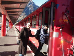 My husband and I getting on board the neat red train at the Tirano station for the Bernina Rail Express Tour... , Nonong - December 2013