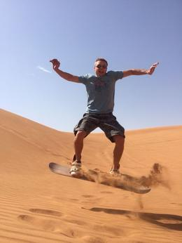 Me Flying off the bottom of the longest sand dune in Dubai. , Adrian S - March 2014