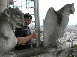 I (James) on the top of the right tower of Notre Dame Cathedral enjoying the view and the Gargoyles!!! , James R - June 2013