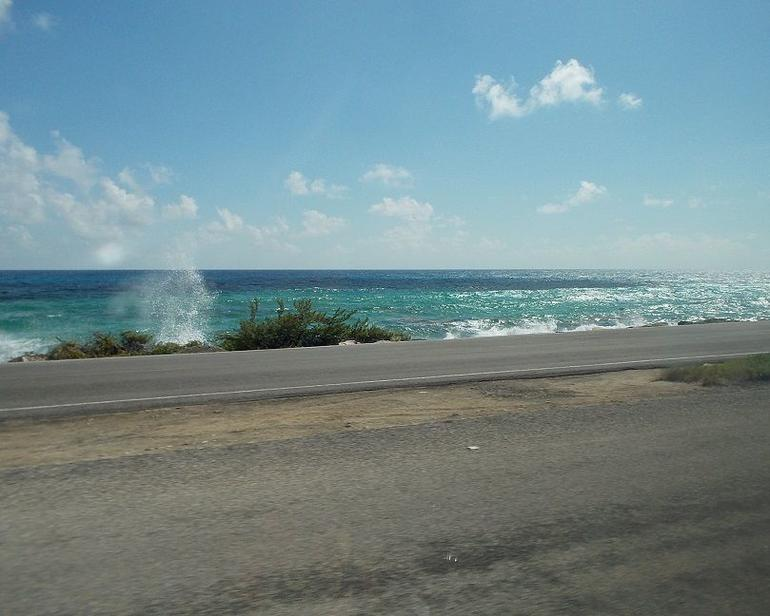 I caught this surf and spray scene from the van, while traveling the north coast road.