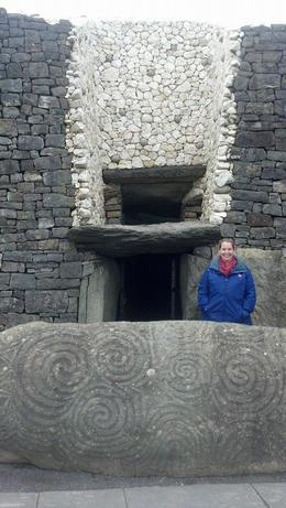 I am in the photo just outside the entrance to the tomb at New Grange , Katherine D - April 2014