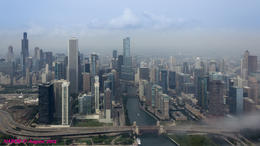 Chicago City Skyline viewed while flying over the Chicago River Locks at Lake Michigan. Note the fog rolling off the lake. , N Robert A - August 2014
