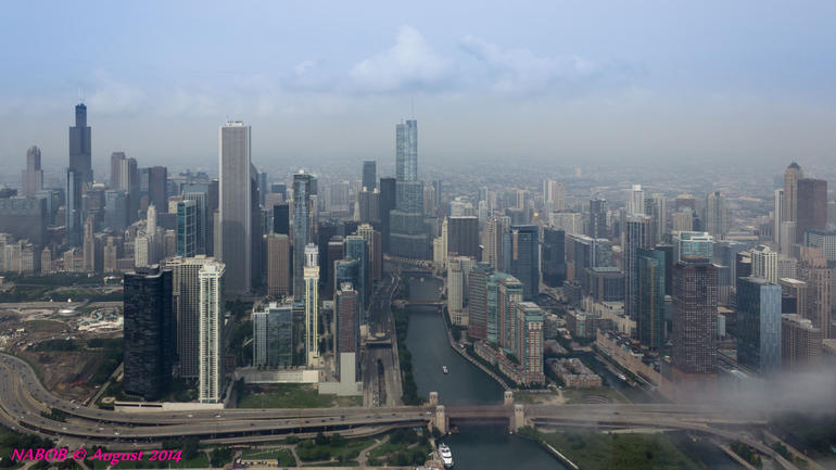 Chicago City Skyline viewed while flying over the Chicago River Locks at Lake Michigan. Note the fog rolling off the lake.