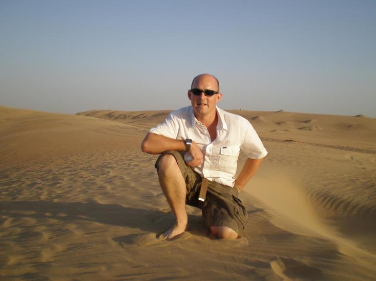 Steve Chapman at the top of the dunes - Dubai