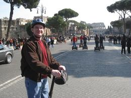 My buddy on Segway within view of the Colosseum. Note the army of Segways in the background -- that's our group. - March 2010