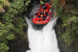 Photo of   group going down rapids