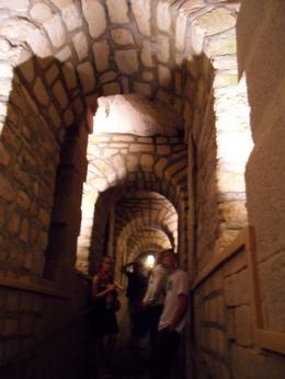 Photo of Paris Skip the Line: Catacombs of Paris Small-Group Walking Tour Underground arches at the Catacombs in Paris