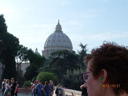 Photo of Rome Skip the Line: Vatican Museums Walking Tour including Sistine Chapel, Raphael's Rooms and St Peter's Inside the Vatican with St. Peter's basilica in the background.